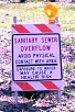Sanitary Sewage Overflow - Avoid Physical Contanct With Area - Exposure to Water May Cause a Health Risk